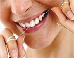 Jak nitkować zęby